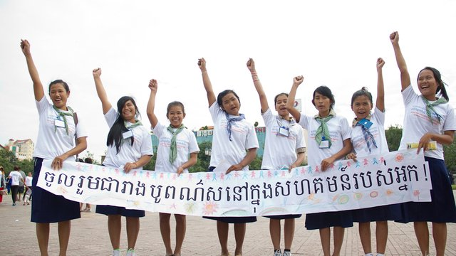 12 2011 Cambodia Stop the violence 16 Days Campaign Girls Holding Sign