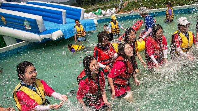 GS Korea International Camp girls playing in water
