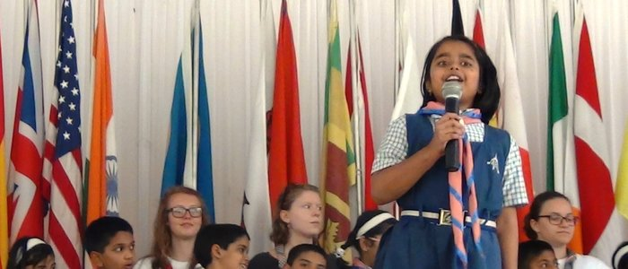 India - girl speaking with flags