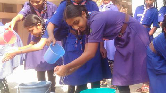 girls washing hands