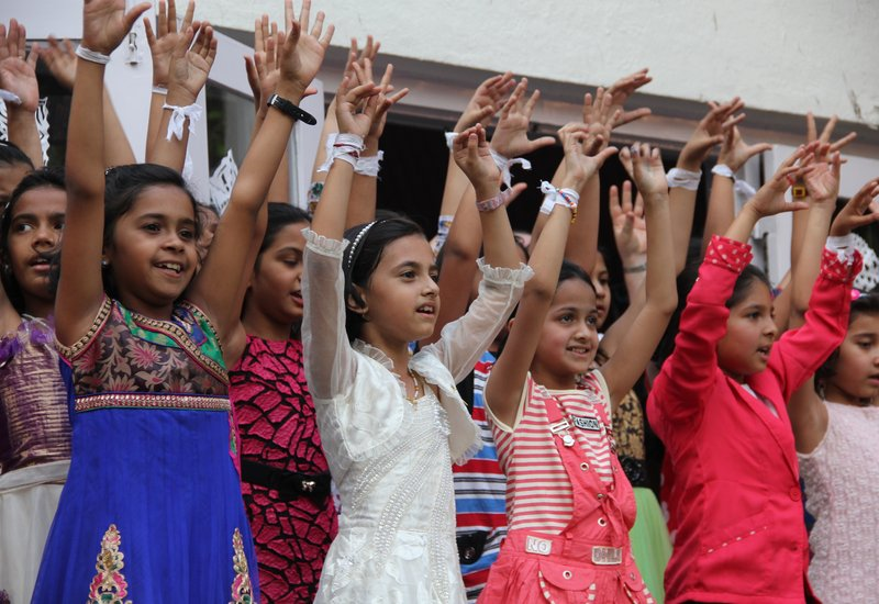 India Girls waving
