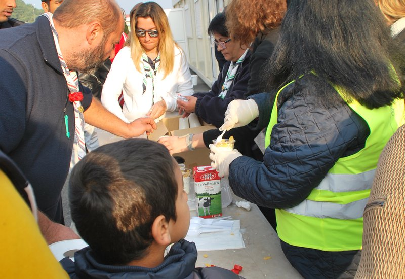 Serving food at the refugee camps